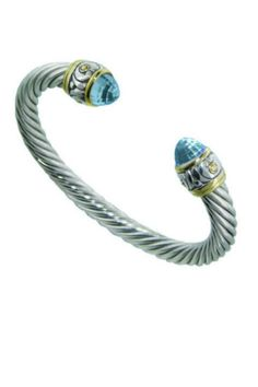 Two-tone cuff bracelet featuring cubic zircon accents on either end. Aqua Cubic Zircon Stone. Cuff has memory wire to shape to wrist as desired. Rhodium plated premium alloy and 14 KT Gold plating.    Measures 7 mm   Large Wire-Cuff Aqua by JOHN MEDEIROS. Accessories - Jewelry - Bracelets New York