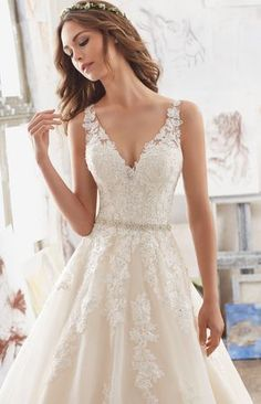 Embroidered embellished aline wedding gown: http://www.stylemepretty.com/2016/12/07/searching-for-the-perfect-lace-bridal-gown-we-found-it/ #sponsored