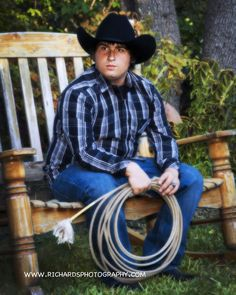 Senior Portraits San Antonio Tx - Cowboy with Hat On Bench With Rope - Richard's Photography Texas