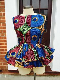 Collection of the most beautiful and stylish ankara peplum tops of 2018 every lady must have. See these latest stylish ankara peplum tops that'll make you stun African Blouses, African Tops, African Dresses For Women, African Print Dresses, African Attire, African Wear, African Fashion Dresses, African Women, Ghanaian Fashion