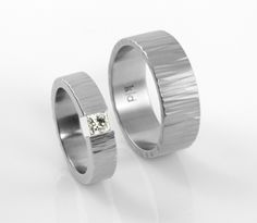 upcycled princess-cut diamond tension-set stainless steel and matching cross-hammered band