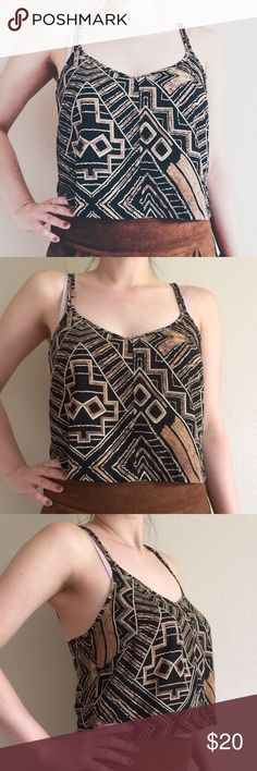 """Geometric Print Crop Top This top is perfect for summer! It is black and yellow-ish orange It is flares where the two straps meet, in front (on the left and right). For reference, I am 5'4"""" and a 34D—it may not be a crop top on everyone. 100% Polyester. 0508174.  ✅Reasonable offers welcome! ✅BUNDLE DISCOUNTS! 🚫No trades/paypal/other apps. 🚫No lowball offers. Stella Laguna Beach Tops Crop Tops"""