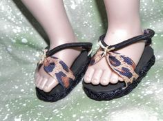 18 inch Doll Bungie Sandal with Leopard by KerwoodFurnitureMore, $6.00. These sandals are made with Bungie elastic and Leopard Grossgrain ribbon for Straps. We used Black Nylon rope braided to bind the soles off these adorable sandals. The Bungie elastic makes it very easy to put on and off, and snugs the foot when on doll so they won't fall off.     We use foam rubber for the soles so they can be washed by hand with damp cloth for easy cleaning.