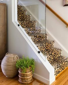 Yes or No? I think there's something so cool about leopard print carpet | by Powell Brower Interiors, location: Virginia | #staircase #leopardprintcarpet #foyer
