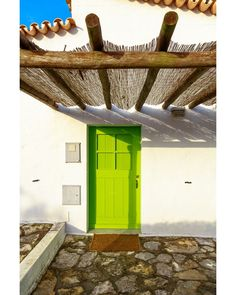 """It's Two Door Tuesday again. Second door for Tuesday is this AWESOME lime green door with wicker porch. - GPS 3924'39"""" N 913'21"""" W #Doors #Portas #Photography #Art #Textures #Portugal #Series #Canon #loveofdoors #doorsagram #Beautiful #lovely #outdoors #instalike #instagood #love #follow #followme #lightroom #instafollow #like4like #photooftheday #ihavethisthingwithdoors #world_doorsandwindows #chasing_facades #me #cute #smile #shy"""