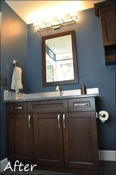 Loving the navy walls. This color we can pull from our entry Chevron wall into the lower bathroom remodel!! I love ideas:)
