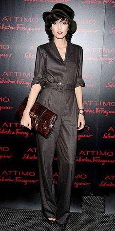 Irina Lazareanu in Ferragamo jumpsuit and oversized clutch
