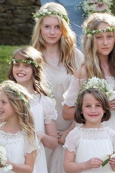 Kate Moss's flower girls....every one sports a slighty different hair garland!