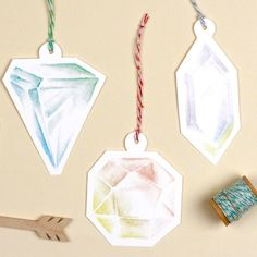 <p>These gift tag printables in the shapes of colorful Gemstones will adorn any of your holiday packages and gifts. This printable template comes with 5 unique gift tag designs in a variety of pretty colors. There is plenty of room for a personal message on the back of the gift tag. </p><p>All you have to do is download the PDF and print the file via Adobe Acrobat. Cut out the different shapes, punch a hole in the top and attach a fun piece of twine. Have fun!! </p>