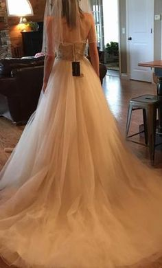 Justin Alexander 8724 4: buy this dress for a fraction of the salon price on PreOwnedWeddingDresses.com