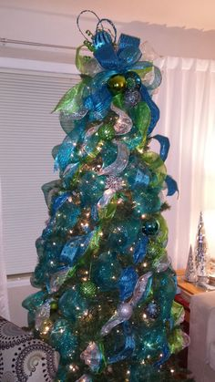 Aqua and lime green Peacock themed Christmas tree. Description from pinterest.com. I searched for this on bing.com/images Peacock Christmas Tree, Teal Christmas, Christmas Tree Design, Whimsical Christmas, Beautiful Christmas Trees, Christmas Tree Toppers, Xmas Tree, Christmas Holidays, Christmas Tree Decorations