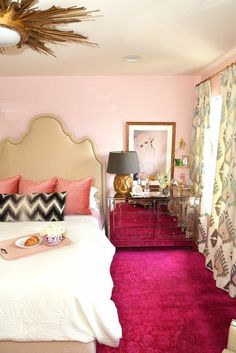 Jewelry makes the best decor... // Dalliance Design // pink walls + brass + hot pink carpet + mirrored dresser + gold + upholstered headboard