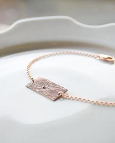 Map Bracelet by Olive Yew. Our simple map bracelet keeps that one special place close to your heart.  Available in silver, gold and rose gold.