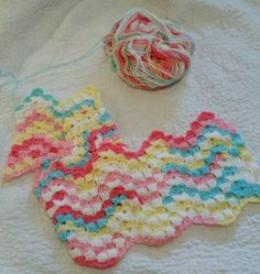 Camille's Vintage Rippling Blocks crochet pattern - see Ravelry, Lion Brand Big Scoop Ice Cream Yarn, Tutti Frutti.