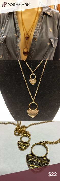 Double strand goldtone long necklace with pendants Get your bohemian on with this long pendant goldtone necklace. Has an antique like finish on the pendants. Wear it as it is or add charms to the ring. Vintage Jewelry Necklaces