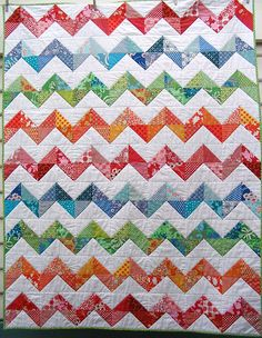 Zig Zag Quilt;  do three zigzags for a table runner.  (There is a tutorial link on the Red Pepper Quilts webpage for a quick half square triangle method.)