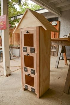 Free-Lending Library - 3 doors, one for each shelf… nice. Rather large but a well resolved design.