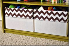 The basket is made from a diaper box and she gives a tutorial on how to make the cute chevron liners