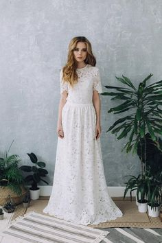 Perfect wedding dress in warm white color. Lace dress with sleeves of medium length. Open laced back. A thin belt at the waist. The fluffy skirt. Dress is made according to individual measurements of the buyer. We recommend you to wear underwear in a nude Modest Wedding Gowns, Elegant Wedding Gowns, Princess Wedding Dresses, Perfect Wedding Dress, Boho Wedding Dress, Elegant Dresses, Boho Dress, Vintage Dresses, Elegant Gown