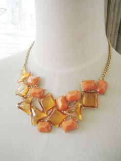 necklace - http://zzkko.com/n214642-outh-Korea-trade-jewelry-fresh-and-elegant-atmosphere-geometric-quality-acrylic-orange-sweater-short-clavicle-chain-necklace.html $5.39