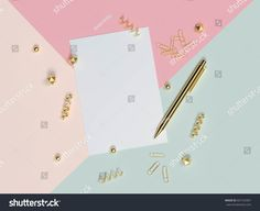 Empty black frame mock up with decorative elements on pink wall background and white table surface 3D illustration