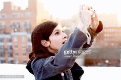 Stock Photo : Girl (10-11) using digital camera downtown