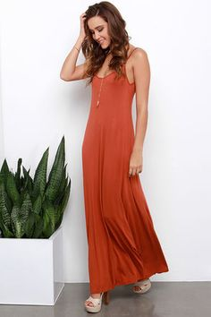 Greet the day, and kick off an amazing evening all with the Sunset the Pace Rust Orange Maxi Dress! This essential jersey knit dress has a strappy triangle bodice that meets a strap that crosses over the V-back. The relaxed silhouette flares slightly to a chic maxi length. Unlined. 95% Rayon Modal, 5% Spandex. Hand Wash Cold. Made With Love in the U.S.A.