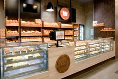 Interior Design of new Bakery. Involved hand drawn visualisations, detail drawings Project also involved conceptualisation of Branding (including packaging and stationery) for Bakery. Completed whilst contracted to Morris Selvatico, Interior Design, Sydne…