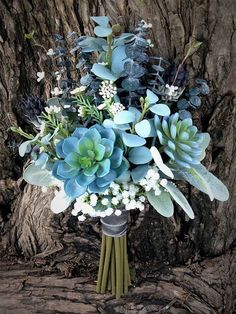 Gorgeous blue succulents, mixed with sage greenery ,ivory florals, and charcoal accents, this hand-tied bouquet will coordinate with a variety of wedding color choices. . Pair this bouquet with your mint, tiffany blue, grey or charcoal bridesmaid dresses. This bouquet looks great against