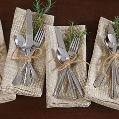 For a rustic twist to your Thanksgiving tablescape, bundle together dinner guest's silverware with a sprig of rosemary, and fasten with twine. #Thanksgiving #rustic #tablescape #twine #silverware #birchlane