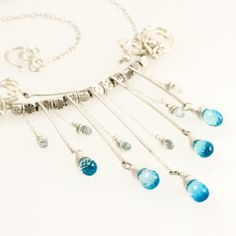"""Sun Shower"" Blue topaz, fine and sterling silver wirewrapped necklace by Sabrinah Renee, boutique jeweler"