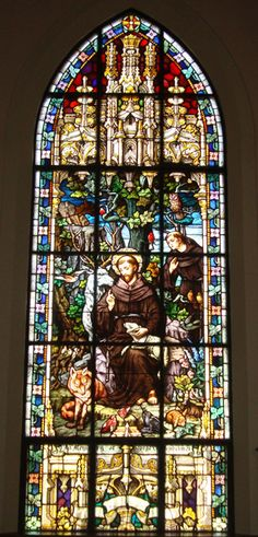 Stained Glass 4 - Probably the most charming and beautiful of windows in the Church, it depicts St. Francis in a setting which testifies to his love for the creatures of the world.