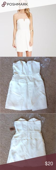 """NWT Forever 21 Contemporary ivory strapless dress Brand new w/ tags. Forever 21 Contemporary strapless mini dress in ivory. Fully lined, concealed back zipper. Midweight. Shell: 97% polyester, 3% spandex; Lining: 100% polyester, 26"""" bust to hem, 30"""" chest, 28"""" waist. Let me know if you have any questions. Forever 21 Dresses Mini"""