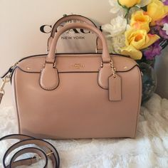 """Coach Mini Bennet satchel Nude/Gold A 100% Authentic & Brand new. Crossgrain leather. Nude/light pink and gold tone hardware! Top zip closure. Handles with 4"""" drop. Longer strap for shoulder or crossbody wear. Cheaper @ MERC Coach Bags Satchels"""
