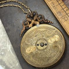 Antique steampunk necklace circa 1910-1920 8 Day Pocket Watch Mainspring Cover.