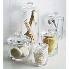 Shop Medium Glass Canister. Simple bathroom storage with a retro feel. Handmade glass canisters with nesting lids update a classic apothecary look.