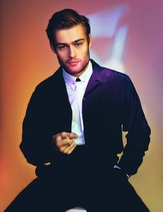 Reunited–British actor Douglas Booth joins his Noah co-star Emma Watson for Wonderland's latest cover shoot. Posing for cheeky images, Booth is photographed by Christian Oita. Lending a subtle edge to his look, stylist Matthew Josephs puts Booth in pieces from Prada and Alexander McQueen…fitting since Booth recently wore McQueen to the Noah world premiere.