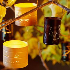Tin can luminarias using #recycled tin cans (use different designs for other holidays/seasons)