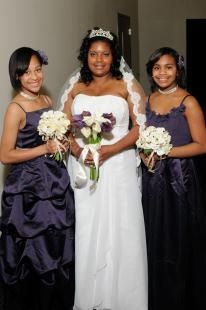 Cherita chose silk cream hydrangea with a  purple ribbon wrap for her bridesmaids bouquet.