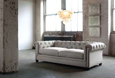 Jayson Home Spring Summer 2012 catalog, featuring the Theodore Sofa, Muriel Chandelier and Baptiste Prints.