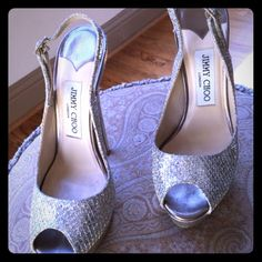Jimmy Choo platform slingback Beautiful shoes hard to part. Super comfy. Size european 36.5 (6.5 us). Light gold dust color. I got a 6.5, because european shoes run slim and I have more of a wide foot. I normally wear between a 6 and 6.5 size. The heel is amazingly 6 inches and the front platform is over 1 inch thick. This was bought at Dallas Highland Park Village. Only worn a couple of times. ** will trade to something  equal or reasonable to*** Jimmy Choo Shoes Platforms
