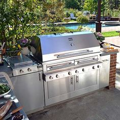 Kalamazoo: High end grill that allows you to cook with gas, charcoal, and wood.