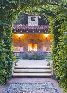 Vine covered archway and a stone fireplace, ahhh