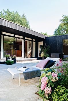 This Black wooden clad house designed by Bak Architects for their very own Rasmus Bak and family. Open plan living with the best of Scandinavian designer products, including Vola , Arne Jacobsen, Carl Hansen & Son, Marimekko, and much much more. All I know is, if I had this summer house, I'd never want to leave!!! Source – Bo Bedre Photographer : Andreas Mikkel Hansen