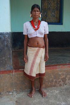 Kondh Woman wears the traditional ear ornaments.
