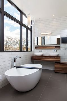 Modern white + wood bathroom design by Nexterra Green Homes Ltd.  I love this..