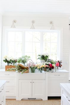 Blooms on blooms in a bright white kitchen