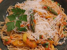Angel Hair Pasta with Spring Vegetable and Red Pepper Tomato Sauce For recipe visit http://easyhomemade-recipes.blogspot.com/2014/02/angel-hair-pasta-with-spring-vegetable.html