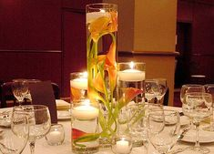 single cylindrical vase on each table; which you can purchase in bulk from The Dollar Tree