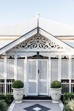 After 14 years of well thought out interior and exterior renovations, this old timber worker's cottage in Brisbane has been transformed into a luxurious yet low-maintenance home to last the ages. Hamptons Style Homes, Cottage Style Homes, Veranda Railing, Queenslander House, Entrance Ways, Victorian Terrace, Front Entrances, Australian Homes, Types Of Houses